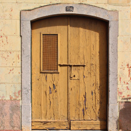 exploringthecitystreets oldbuilding yellowwooddoors locked grungetexture